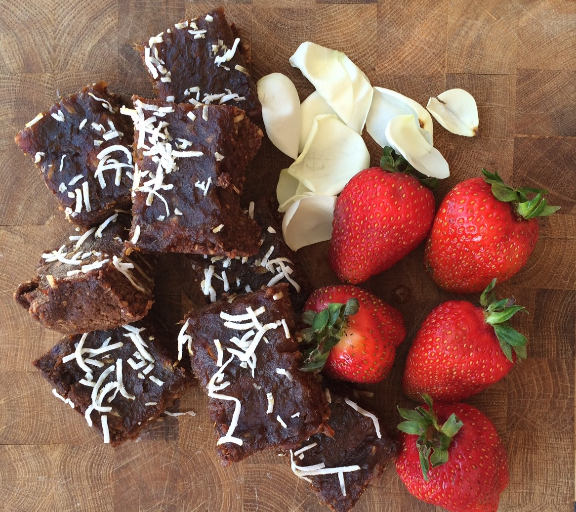 Raw Date and Almond Slice served with strawberries