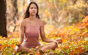 inhale Life - Meditation transformation - woman meditating in forest